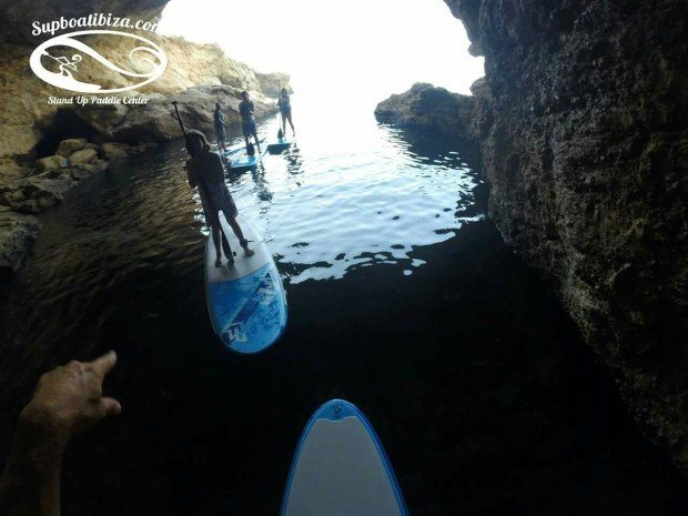 Exploring the caves by paddle board