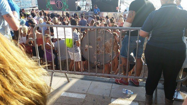 Dangerous use of crowd barrier and shows the confined space for the crowd below the steps of Mambo