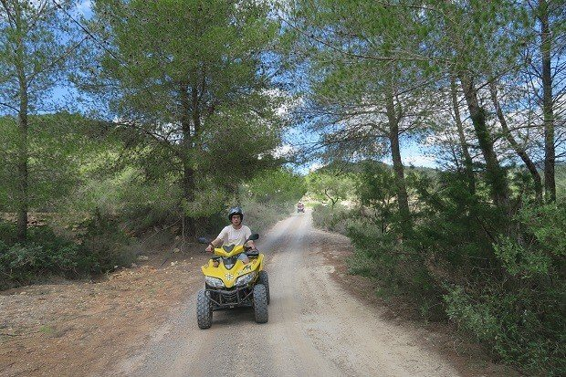 Travelling through the pine forests of Ibiza on quad bikes.